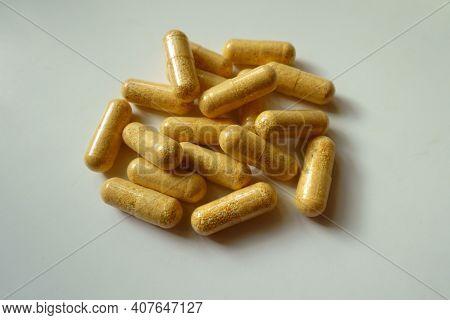 Heap Of Orange Cellulose Capsules Of Multivitamins