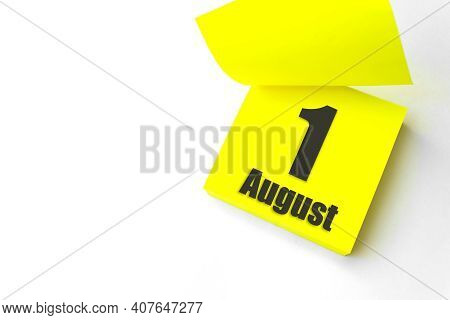 August 1st . Day 1 Of Month, Calendar Date. Close-up Blank Yellow Paper Reminder Sticky Note On Whit