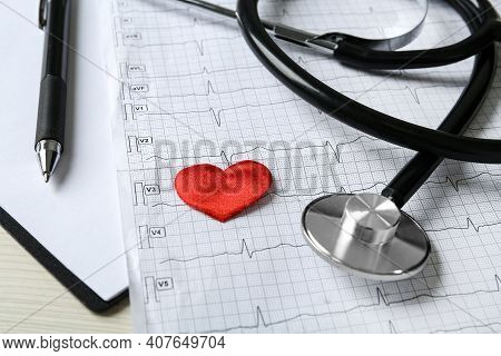Cardiogram Report, Red Decorative Heart And Stethoscope On Table, Closeup