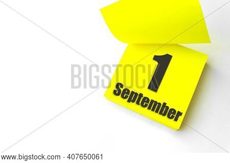 September 1st . Day 1 Of Month, Calendar Date. Close-up Blank Yellow Paper Reminder Sticky Note On W