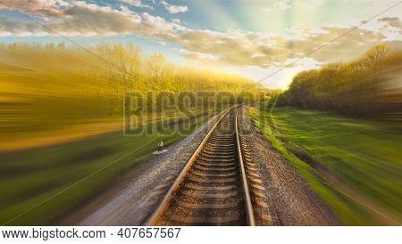 Railway Track With Motion Blur Effect. Blurred Railway. Industrial Conceptual Landscape With Blurred