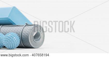 Rolled Yoga Mat And Yoga Block Or Brick