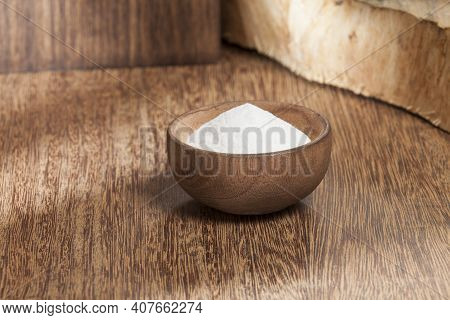 Baking Soda (sodium Bicarbonate) In A Wooden Bowl; Photo On Wooden Background.