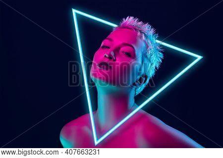 Future. Portrait Of Female Fashion Model In Neon Light With Neoned Blue Glowing Triangle On Dark Stu