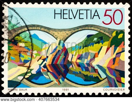 Moscow, Russia - February 11, 2021: Stamp Printed In Switzerland Shows Bridge Of Natural Stone Near