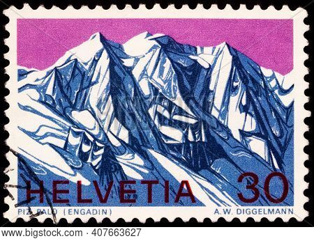 Moscow, Russia - February 09, 2021: Stamp Printed In Switzerland Shows Piz Palu, A Mountain In Alps,
