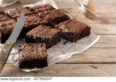 Homemade Pieces Of Brownies On Wooden Table. Copy Space