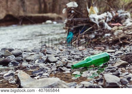 Plastic Bottles And Trash In The River Water. Environmental Pollution. Rubbish And Waste. Plastic An