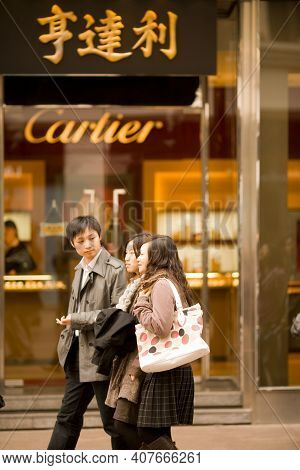 Shanghai, Huangpu District, China, Asia - November 21, 2008: Modern Chinese Youth In Front A Cartier