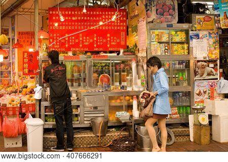 Sheung Wan, Hong Kong Island, Hong Kong, China, Asia - December 04, 2008: A Woman Shopping At Fruit