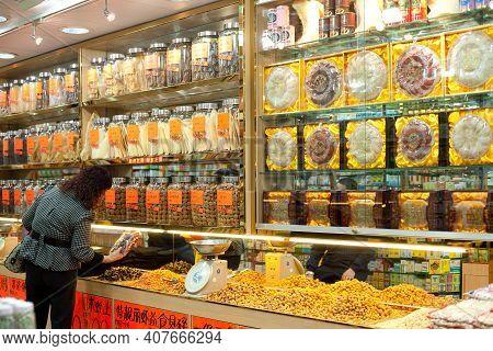 Central District, Hong Kong Island, Hong Kong, China, Asia - December 03, 2008: A Woman Shopping At