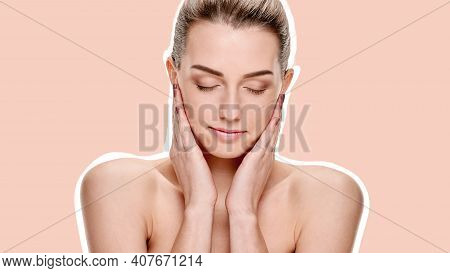 Natural Beautiful Woman With Bare Shoulders Touching Her Clean Face On A Flesh, Skin Colored Backgro