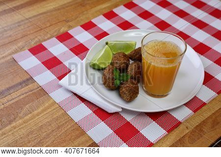 Brazilian Deep Fried Kibe Snack, With Orange Juice And Soda - Popular At Local Parties.