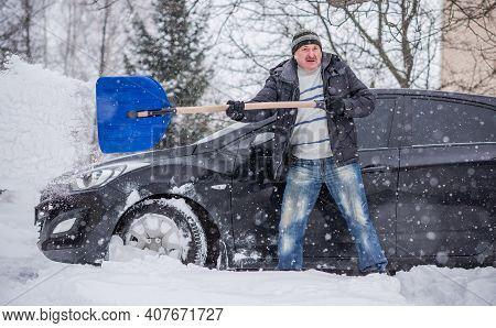 Winter, People And Car Problem Concept. Man Try On Pushing The Car, Stuck In The Snow. Mutual Aid. W