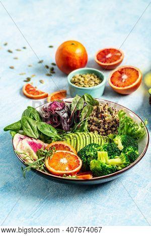 Vegan, Detox Buddha Bowl With Vegetables, Avocado, Blood Orange, Broccoli, Watermelon Radish, Spinac