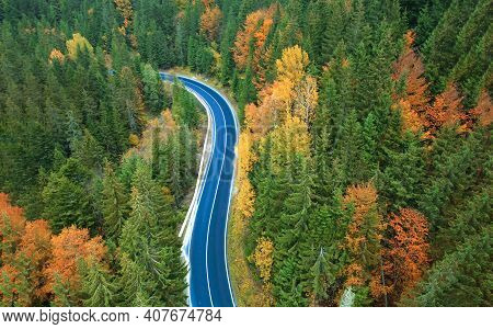 Aerial View Of Road In Beautiful Green Forest At Autumn Sunset. Colorful Landscape From The Roadway,
