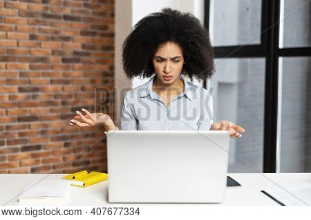 Confused And Surprised Young African-american Businesswoman Received Unexpected News, Sitting At The