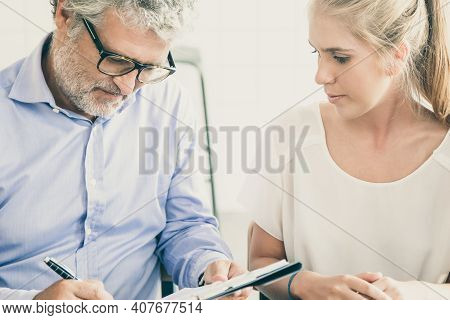 Businessman Meeting With Agent At Co-working, Writing In Paper, Completing And Signing Agreement For