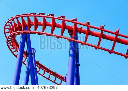 Close-up Image Of A Rollercoaster Track And The Blue Sky