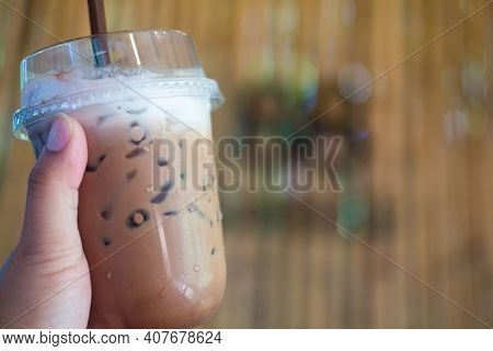 Take Away Cup Of Iced Coffee Mocha With Milk On Hand