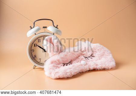 Sleeping Eye Mask, Alarm Clock Isolated On Pink Pastel Colourful Trendy Background. Do Not Disturb M
