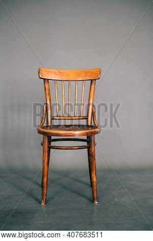 Vintage Wooden Chair Isolated On Gray Background.