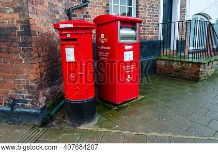 Chester; Uk: Jan 29, 2021: A Royal Mail Parcel Postbox Stands Beside A Traditional Letter Postbox. T