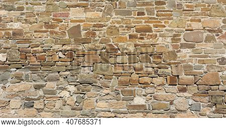 Castle Wall Made Of Old Stones Textures For Design And Photo Background.