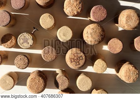 Cork Bottle Bungs Staying On White Wood Background.