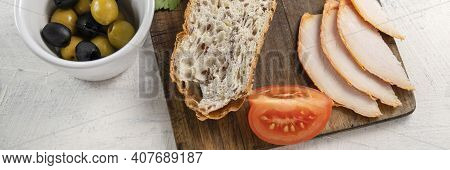 Banner With Spanish Tapas Or Snack Or Appetizer. Sliced Bread On Serving Board With Cheese, Smoked C
