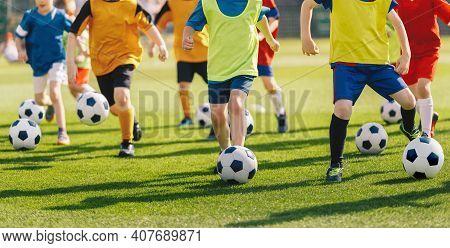 Football Soccer Children Training Class. Kids Practicing Football On Grass Field. Group Of School Ch