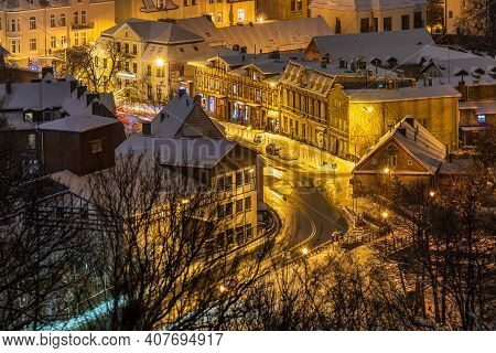 Gdansk, Oliwa, Poland - 16 January 2021 - View Of The Illuminated, Snow-covered Old Town In Oliwa. W