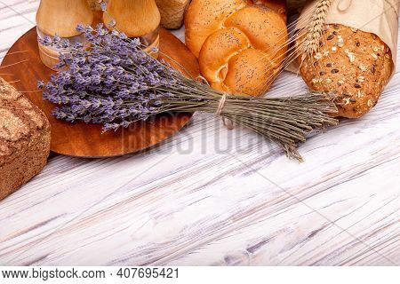 Composition With Tasty Lavender Baking On Wooden Table. Close-up On Traditional Bread. Fresh Homemad