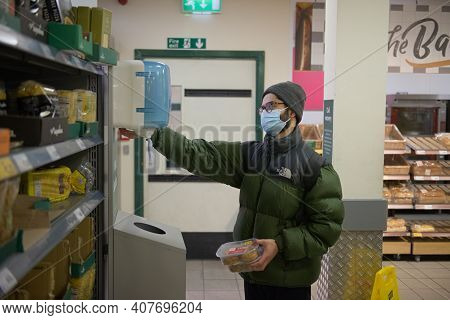 Sheffield, United Kingdom, 14th January, 2021: A Morrisons Customer Sanitises His Hands Due To The C