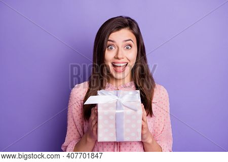 Portrait Of Lovely Amazed Cheerful Girl Holding In Hands Giftbox Greetings Isolated Over Bright Viol