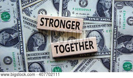 Stronger Together Symbol. Concept Words 'stronger Together' On Wooden Blocks On A Beautiful Backgrou