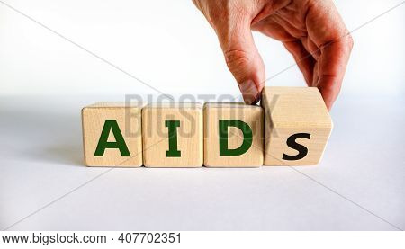 Symbol For Helping People With Aids, Acquired Immunodeficiency Syndrome. Doctor Turns A Wooden Cube