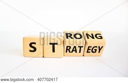 Strong Strategy Symbol. Turned Wooden Cubes With Words 'strong Strategy'. Beautiful White Background