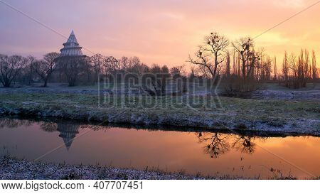 View Over The River Alte Elbe In Magdeburg At Sunrise. In The Background The Jahrtausendturm.