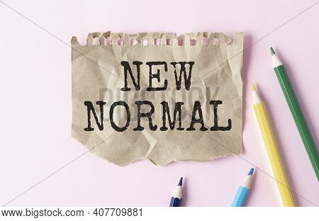 New Normal Text On Note Pad. New Normal Concept After Covid-19 Pandemic