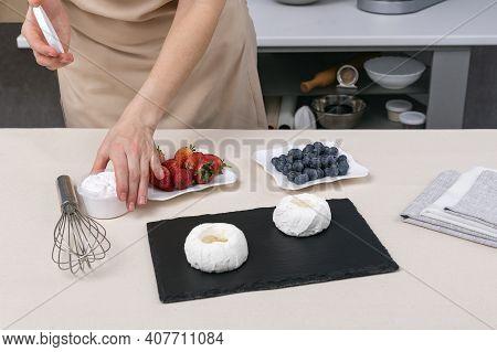 Pastry Chef Prepares Berry Cakes. Process Of Making Cake Anna Pavlova.