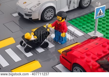 Tambov, Russian Federation - February 07, 2021 Lego Minifigure That Is Pushing A Baby Stroller With