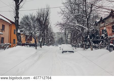 Cars Covered With Snow During Snowfall In City. Automobiles Stuck In Heaps After Winter Blizzard. Ba