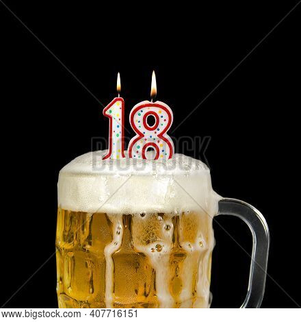 Number 18 Candle In Beer Mug For Birthday Celebration Isolated On Black