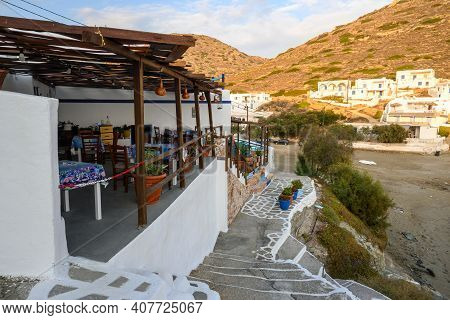 Folegandros, Greece - September 24, 2020: A Seaside Tavern Located On The Cliff At The Agali Beach O
