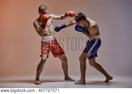 Sparring Of Two Athletic Fighting Males In Boxing Gloves During Battle, Martial Arts, Mixed Fight Co