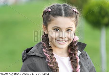 Cute Smile. Fashionable Hairstyle For Kids. Girl Small Kid With Fashionable Braids Hairstyle. Fashio