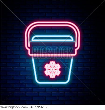 Glowing Neon Line Cooler Bag Icon Isolated On Brick Wall Background. Portable Freezer Bag. Handheld