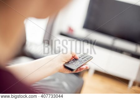 Close Up View Of Tv Remote Control In Hand. Turn On The Tv. Rest At Home