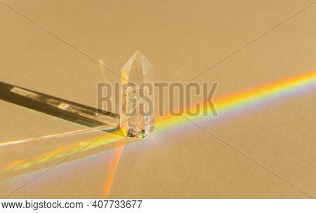 Healing Chakra Crystal And Rainbow On Beige Background. Meditation, Reiki And Spiritual Healing Conc